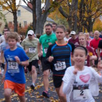 Happy runners starting 5K for Farmland race