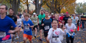 Happy runners starting 5K for Farmland race