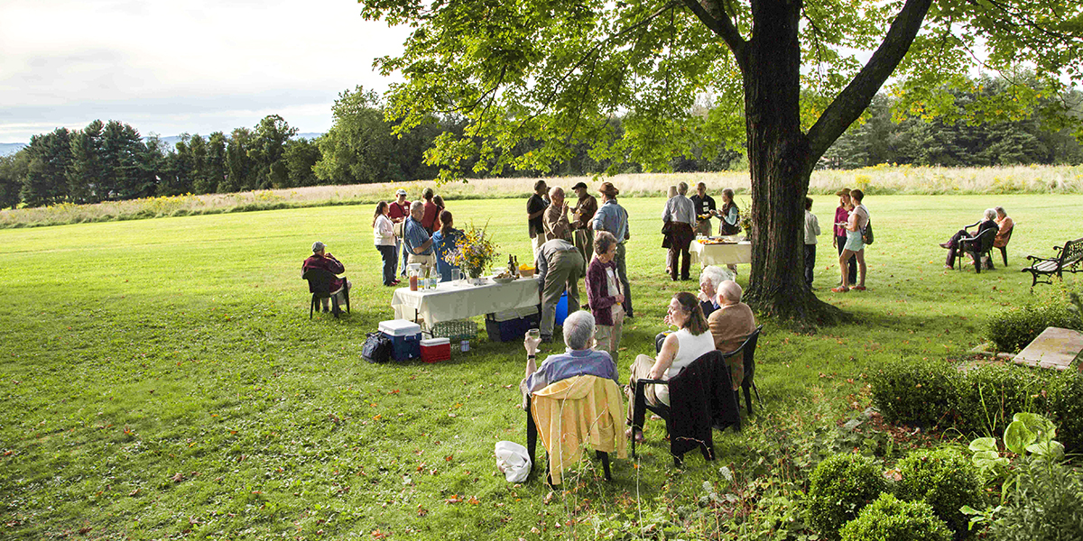 People outdoors at garden party in summer
