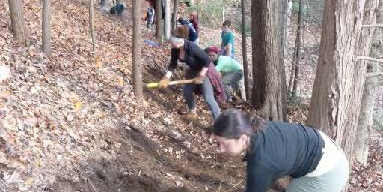 Volunteers digging a new trail