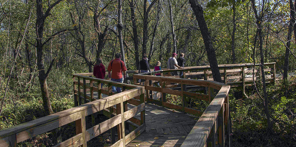 People on boardwalk at Ft River Trail