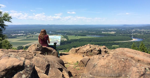 Woman painting a picture on Mt Holyoke summit