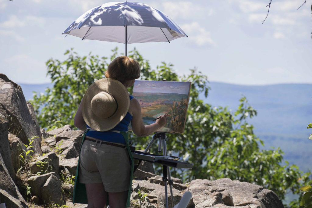 Painter under umbrella