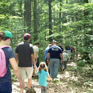 Families Explore Woods With Laurie Sanders.
