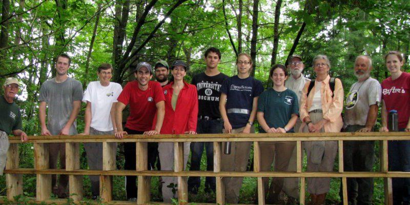 Volunteers Smiling In Woods