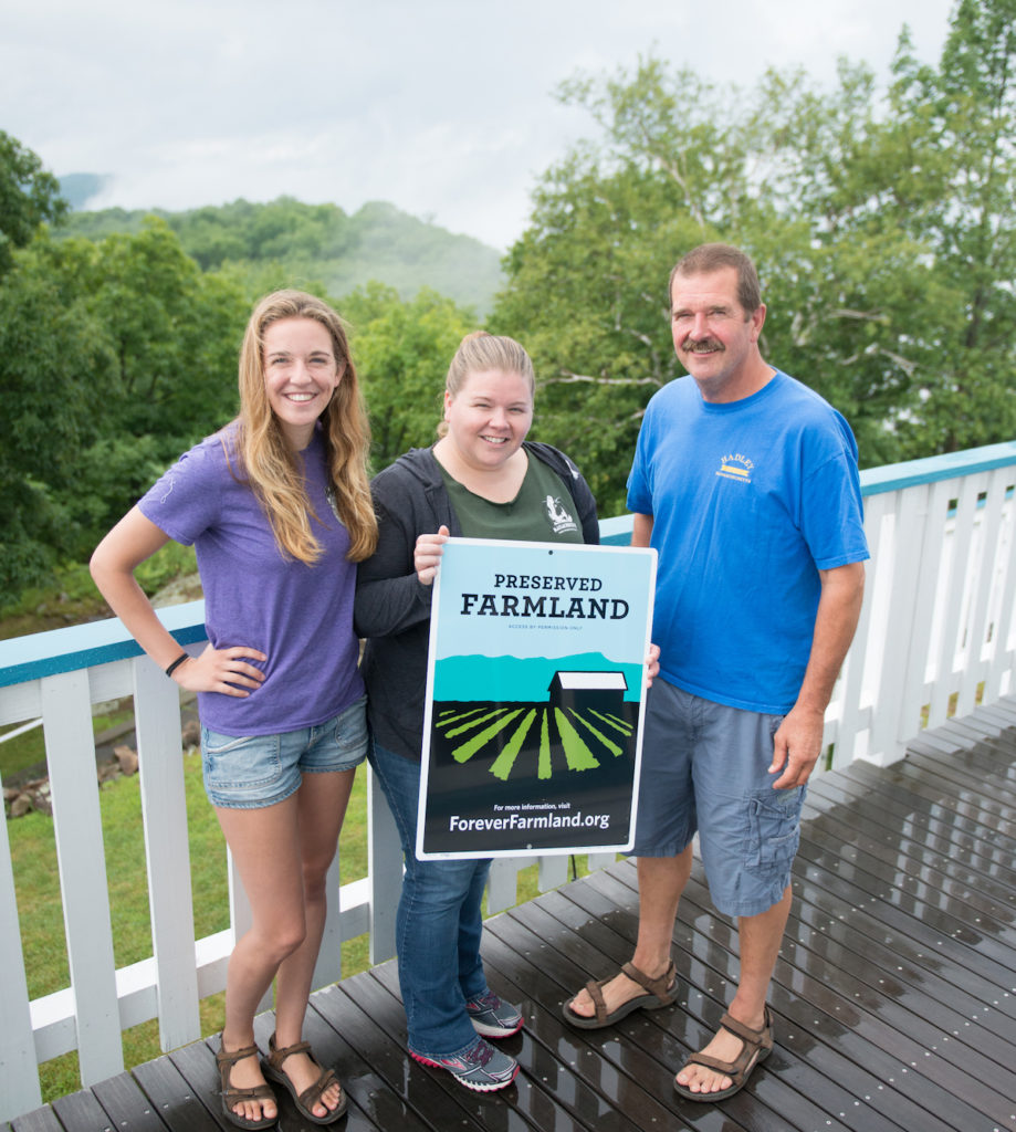 Barstow family with Forever Farmland sign