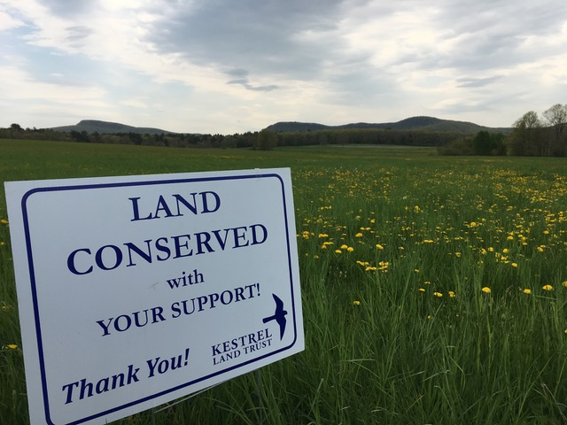 Land conserved sign on field