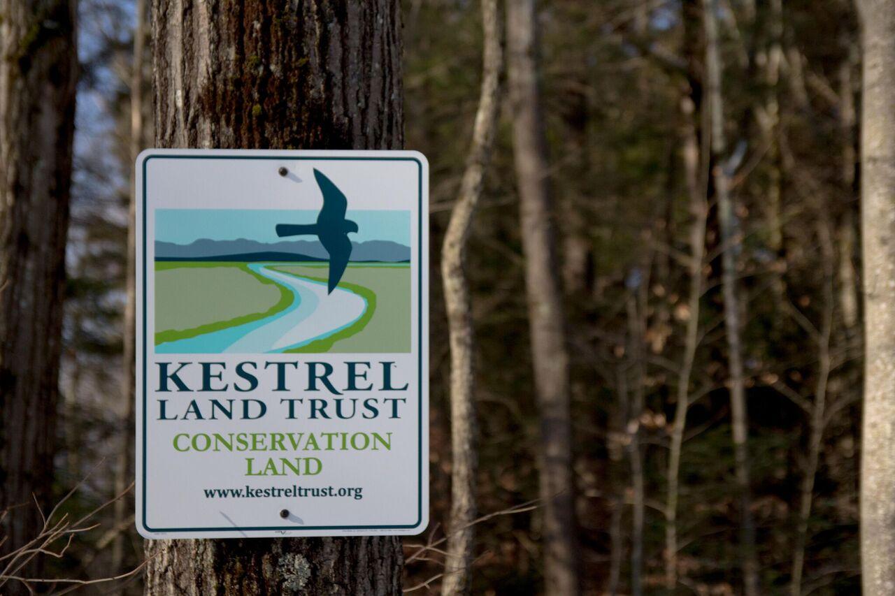 Kestrel Land Trust sign on tree