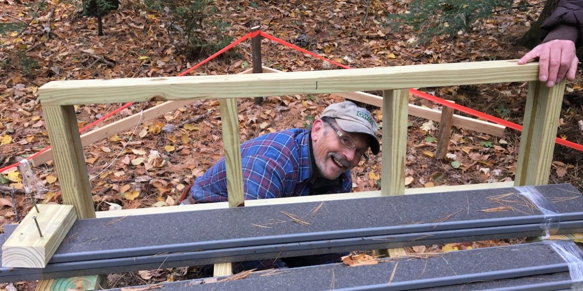 Woodworking volunteer smiling