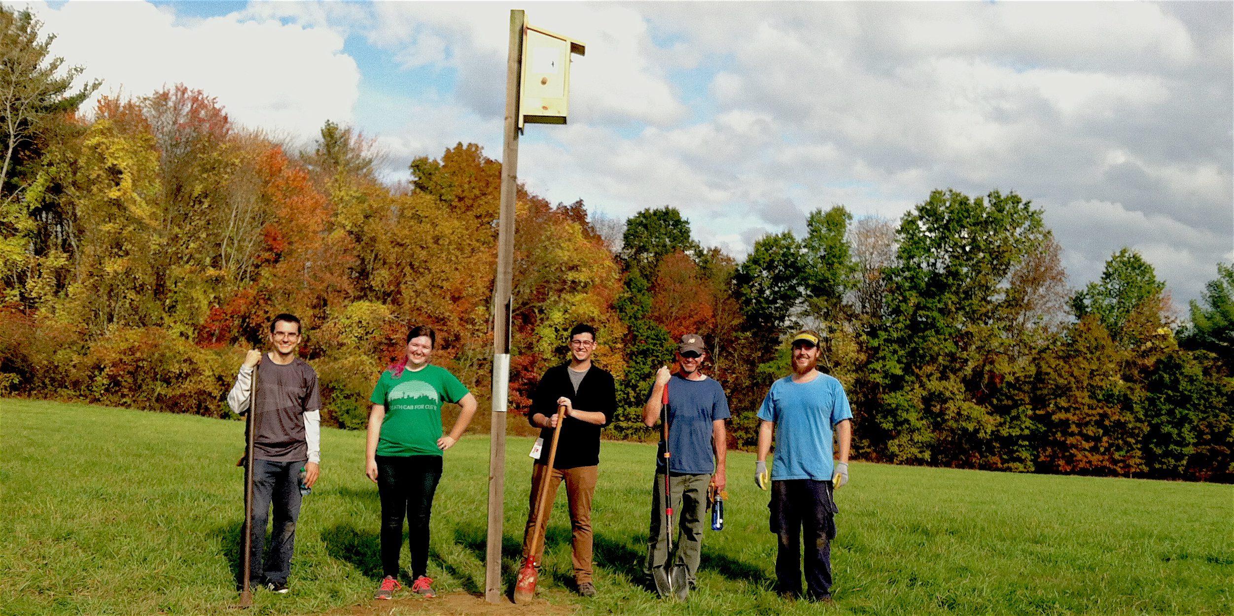 volunteers with Kestrel nest box