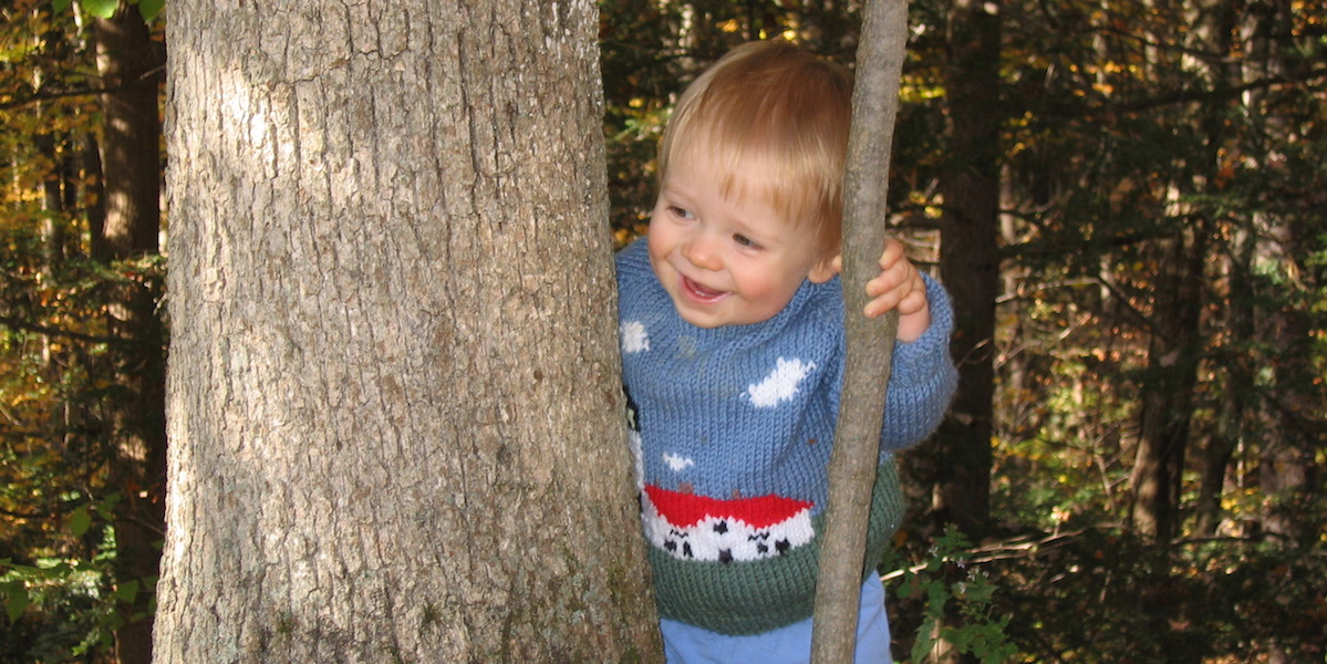 toddler with tree