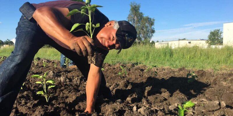 Farmer Planting By Hand