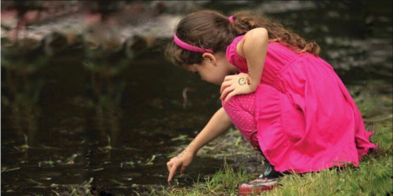 Girl Touching Stream